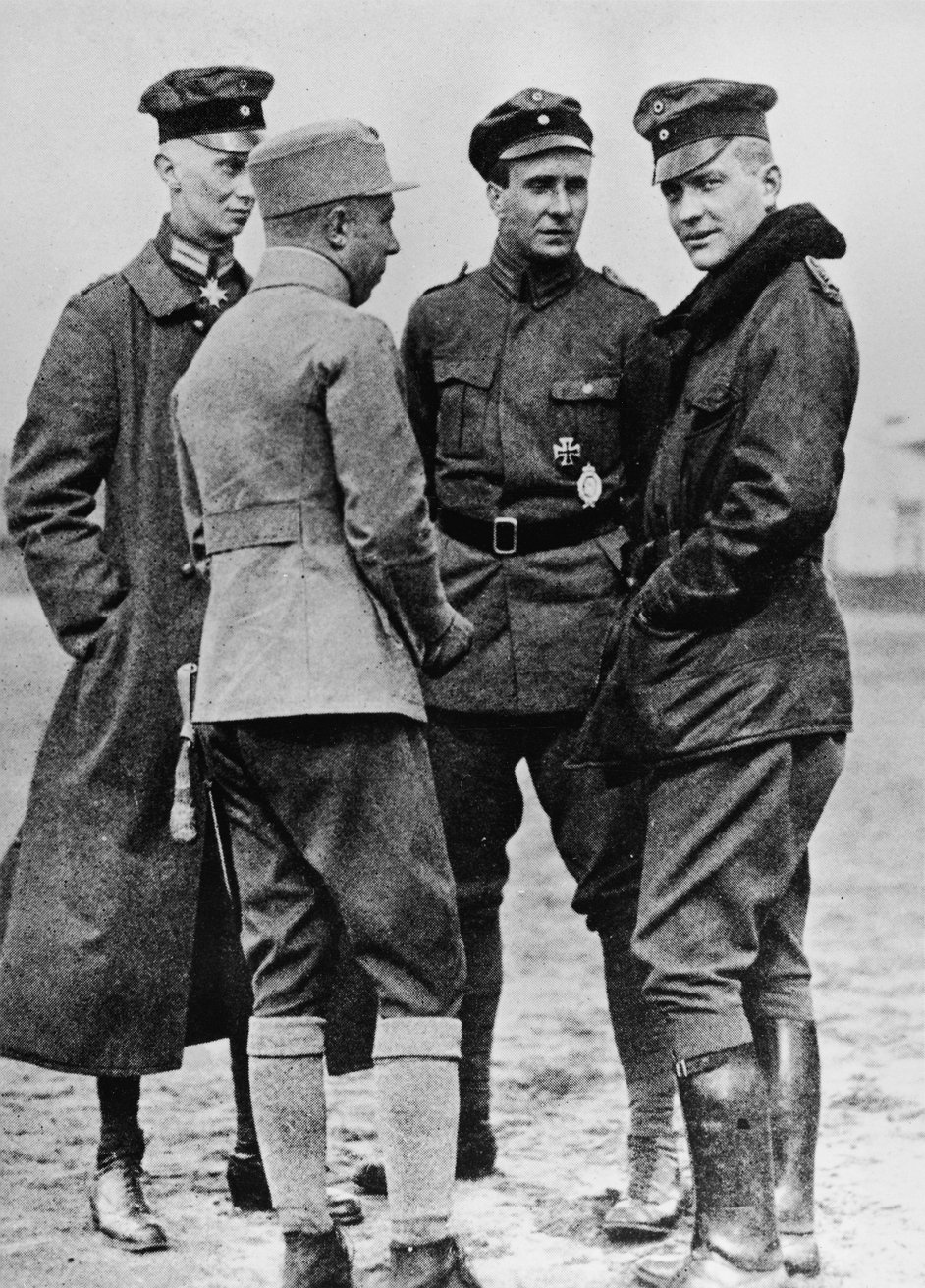 Baron Manfred von Richthofen (1892 - 1918), right, talks to other German officers, 191Os. Von Richthofen, known as the Red Baron, is considered the most successful fighter pilot of all time, racking up 80 air combat battles in less than two years