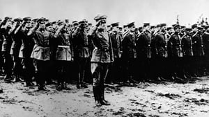 The Red Baron salutes in front of the officers and staff of Fighting Squadron No 11