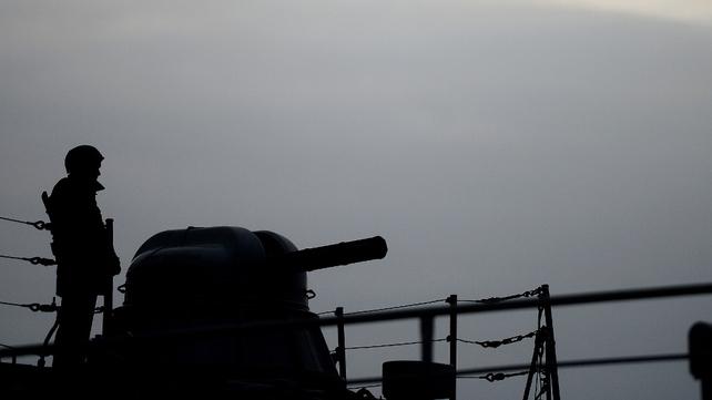 A soldier patrols on board the Slavutich Ukrainian navy ship anchored at the harbor of Sevastopol