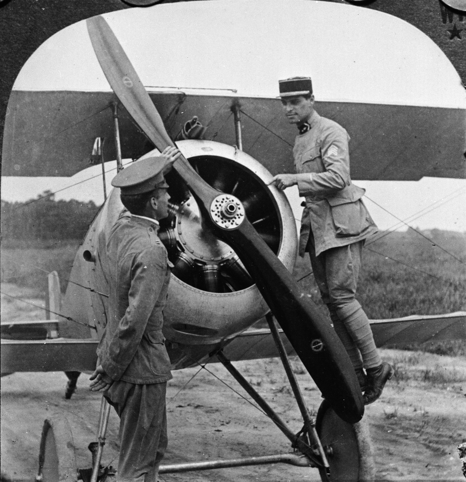 Lt. Le Maitre of the French Aviation Forces in America explains the mechanism of a Nieuport biplane to an American pilot, Fort Monroe, Virginia, 1910s