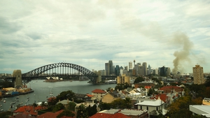 Smoke from a fire at Baranagroo drifts across the Sydney skyline