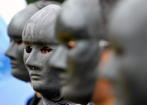 Indonesian Greenpeace activists wear black masks during a protest in front of the economy ministry office in Jakarta, Indonesia urging the government to stop using coal (Pic: EPA)