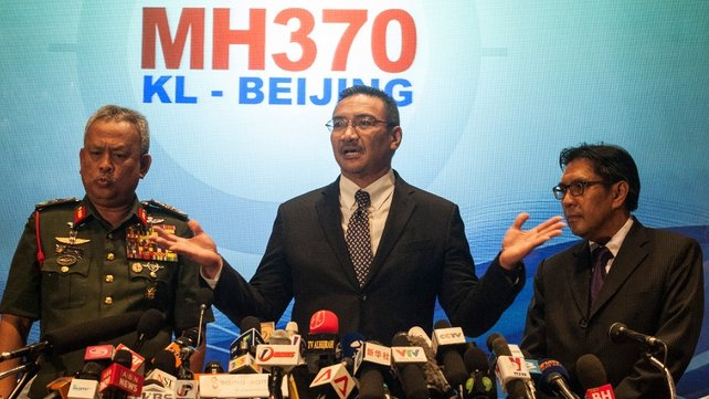 Malaysian Defence Minister and acting Transport Minister Hishamuddin Hussin (C) briefs the media at Kuala Lumpur (Pic: EPA)
