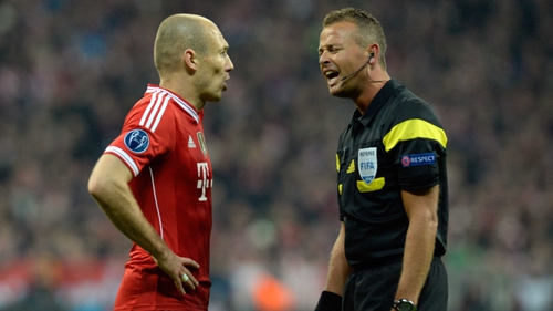 Arjen Robben debates with the referee during last night's match