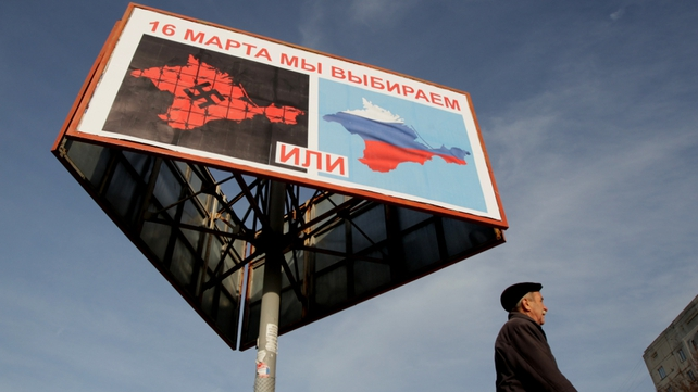 A poster calling people to vote in the upcoming referendum in the Crimea, is seen in Sevastopol (Pic: EPA)
