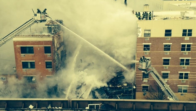 Eyewitnesses said a large bang was heard before a plume of smoke began billowing over the area (Pic: @fdny)