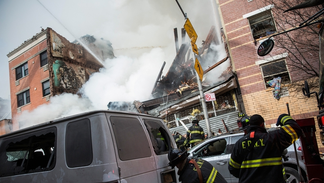 Members of the New York Fire Department are attending the scene at 116th Street and Park Avenue