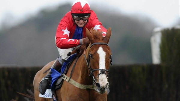 Sire De Grugy turned in a near flawless display to win the Queen Mother Champion Chase