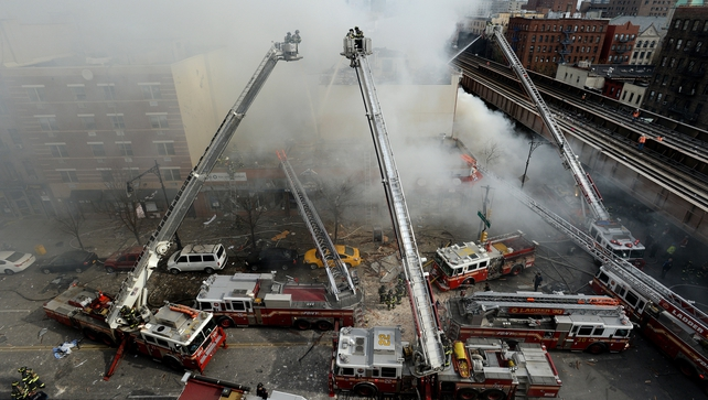 Firefighters battle the huge blaze in East Harlem, New York