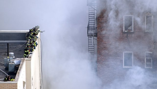 Firefighters from the Fire Department of New York (FDNY) respond to the blaze