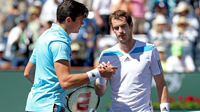 Andy Murray (l) shakes hands with winner Milos Raonic