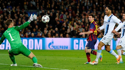 Lionel Messi dinks the ball past Joe Hart in the Man City goal to give Barca the lead