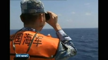 Reports say China released satellite images of debris floating at sea