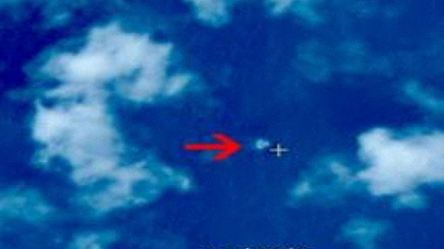 Malaysian authorities said satellite images released are not plane debris in the South China Sea