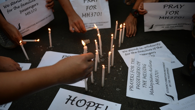 Students in Manila light candles in solidarity with families of the passengers of flight MH370