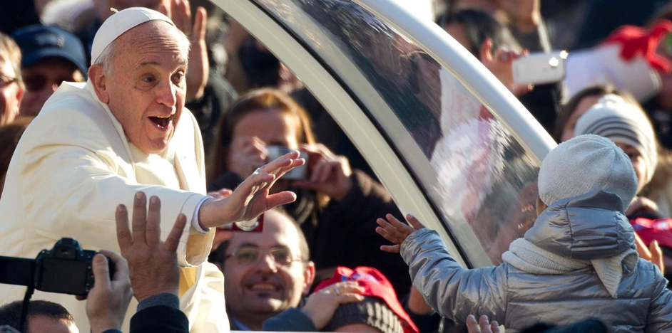 Pope Francis waves to a child as he moves around St Peter's Square (Pic: EPA)