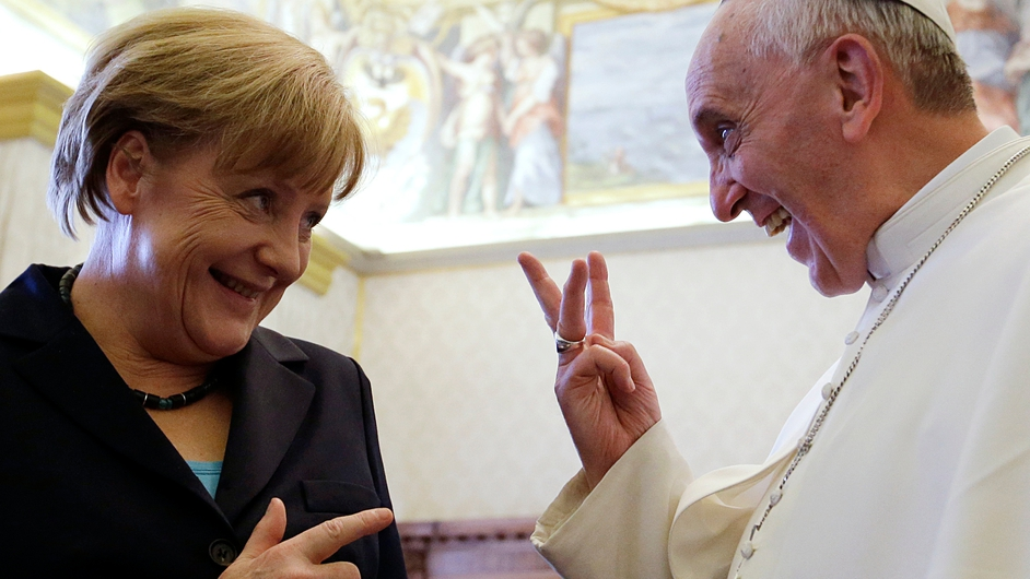 Pope Francis jokes with German Chancellor during a meeting in May last year