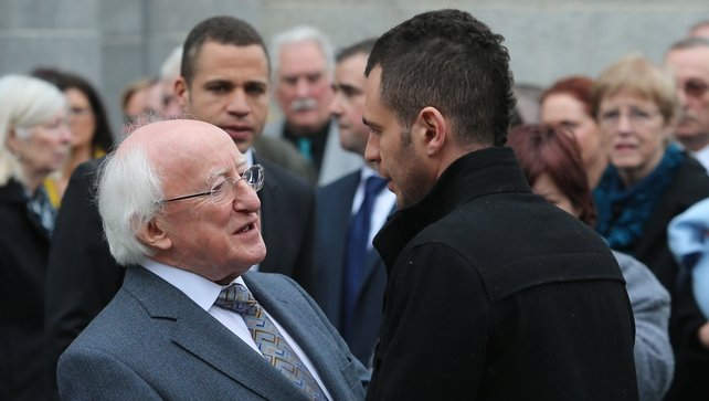 President Michael D Higgins consoles Christine Buckley's son Darragh at today's funeral mass