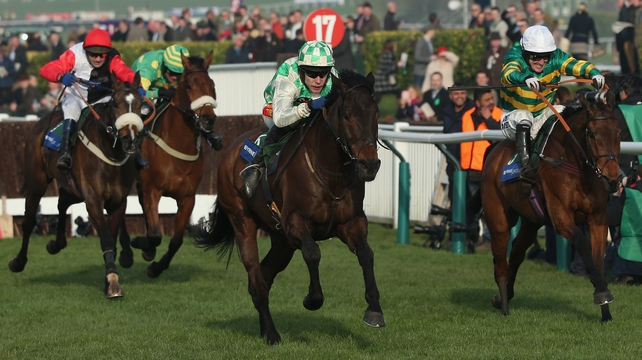 Tom Scudamore on Ballynagour (c) pulls away on the home straight from Tony McCoy on Colour Squadron (r)