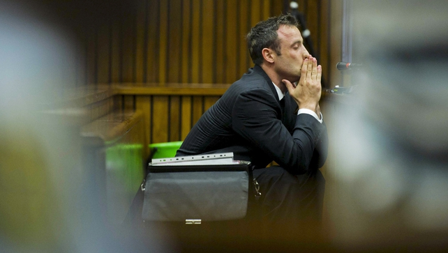 Oscar Pistorius was upset in court when images of Reeva Steencamp's body were shown
