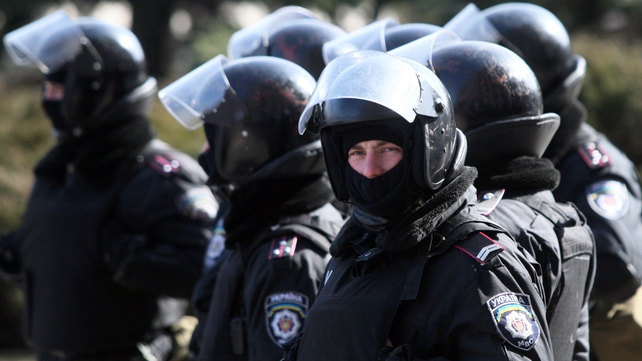 Police officers stand guard in front of the regional state administration building in Donetsk earlier this week