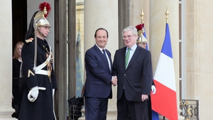 Francois Hollande shakes hands with Eamon Gilmore after a meeting at the Elysee Palace