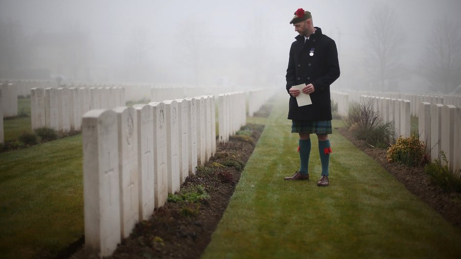 Mr McCleod looks at headstones before the ceremony