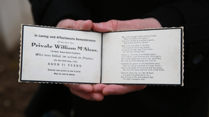 Stephen McLeod, great step nephew of Pte McAleer, holds an original card of remembrance