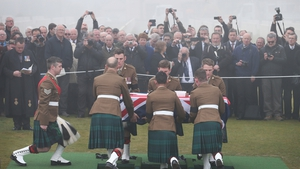 A military firing party fired a salute during the service and the Last Post was played