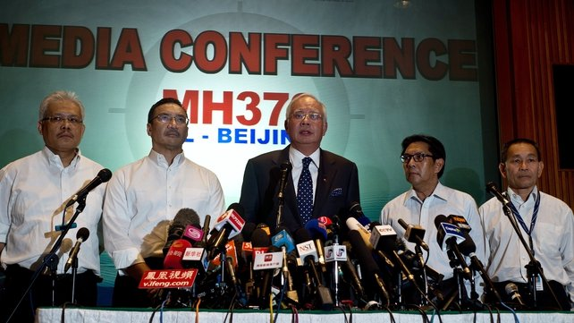 Malaysian Prime Minister Najib Razak (C) addressed the media this morning
