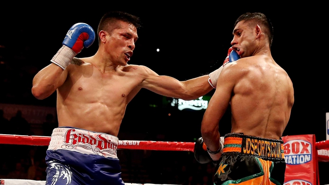 Amir Khan is caught during his victory over Julio Diaz at Motorpoint Arena in April