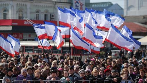 Pro-Russia supporters rally in Lenin Square in Simferopol, Ukraine