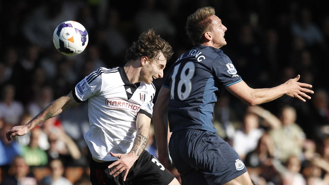 Fulham's Fernando Amorebieta and Luuk de Jong of Newcastle contest a high ball