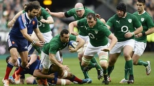 Dave Kearney makes some hard yards with plenty of team-mates in support