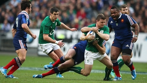 Brian O'Driscoll gets snagged by the French cover