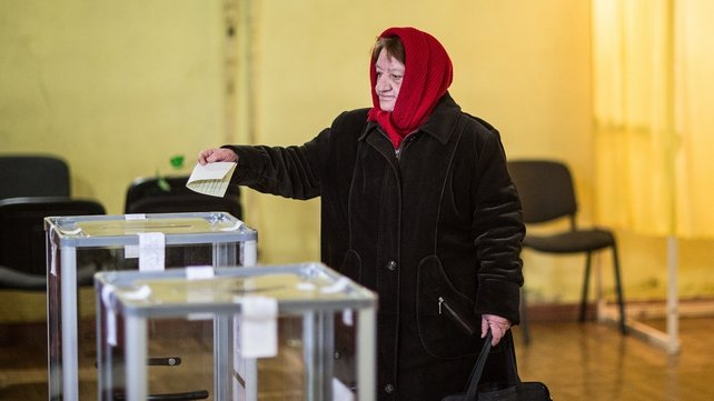 A woman casts her ballot in a polling station in Simferopol (Pic: EPA)
