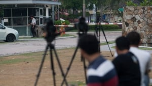 Photographers gathered outside the residence of Captain Zaharie Ahmad Shah (Pic: EPA)