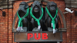 The Three Wise Monkeys Hotel adorned with Irish regalia in Sydney, Australia