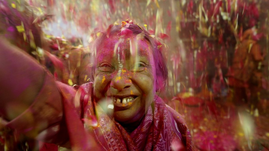 A woman takes part in Holi celebrations in India (Pic: EPA)