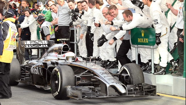 Nico Rosberg is congratulated by his crew