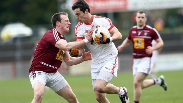 Tyrone's Shay McGuigan with Westmeath's John Gilligan