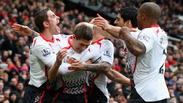 Steven Gerrard is mobbed following one of his two successful penalties