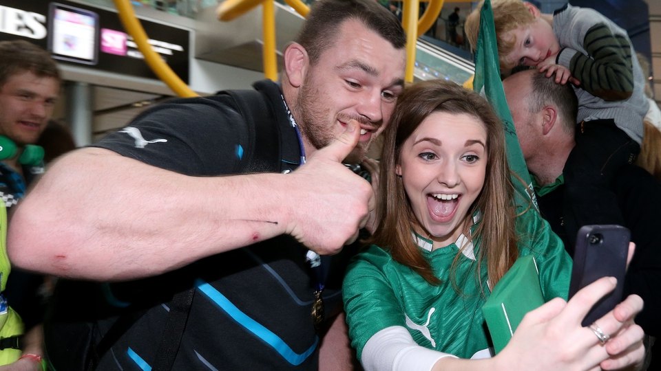 Cian Healy poses for a fan's 'selfie'