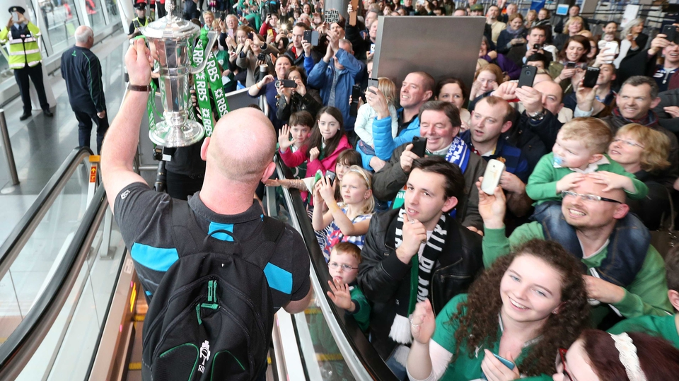 O'Connell displays the trophy to the delighted crowd at Dublin Airport