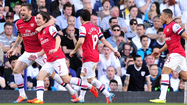 Tomas Rosicky celebrates with his Arsenal team-mates at White Hart Lane