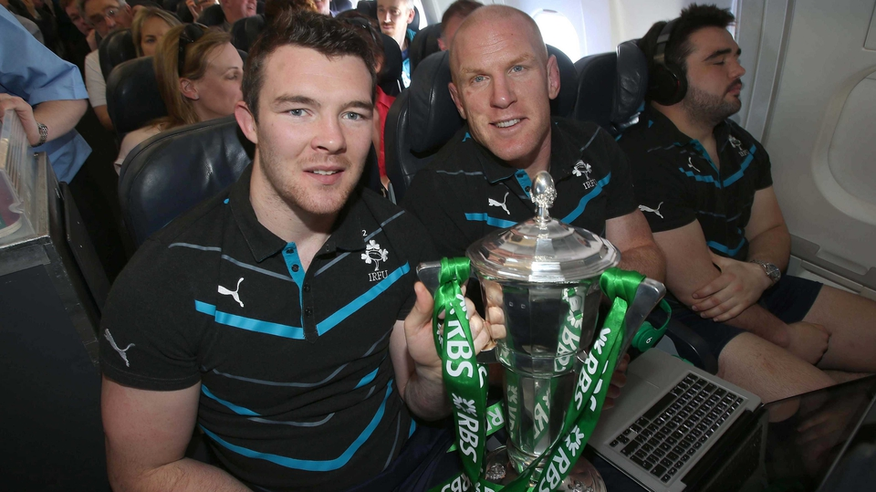 Peter O'Mahony and Paul O'Connell with the Six Nations trophy on the flight home