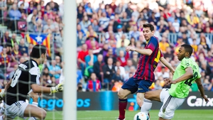 Lionel Messi scores his first of three goals against an Osasuna side that had no answer to Barcelona's attacking prowess