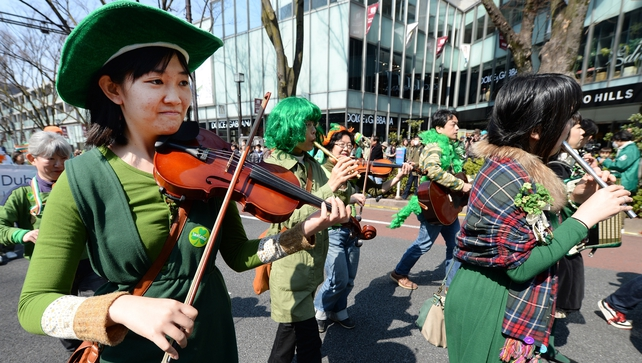 Japanese marchers play musical instruments during the 22nd St Patrick's Day Parade in Tokyo