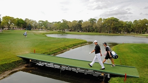John Senden crosses a bridge on the 12th fairway during his final round