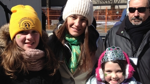 Emma and Holly Cullen with Grand Marshall Katie Taylor at the Toronto St Patrick's Day Parade